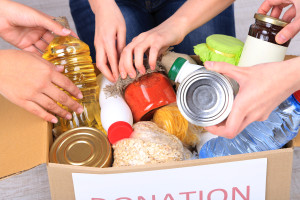 Hands donating food