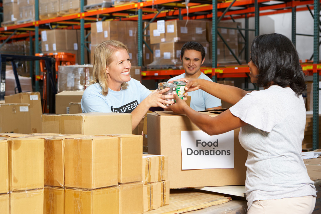 Volunteers collecting donations in warehouse