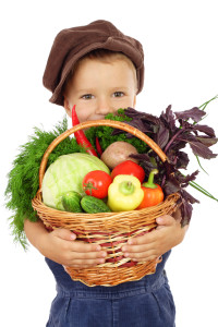 Little boy with basket of vegetables